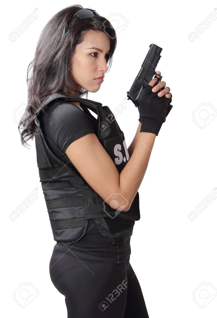 asian woman wearing swat bulletproof vest and holding a gun on her hand Stock Photo - 20547450