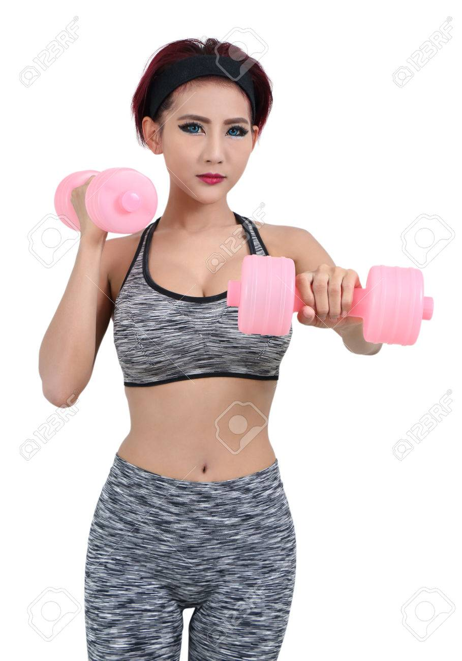 young asian woman in fitness clothes and holding dumbbell Stock Photo - 78927352
