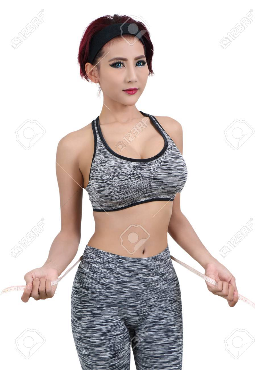 young asian woman in fitness clothes and measuring tape Stock Photo - 78841456