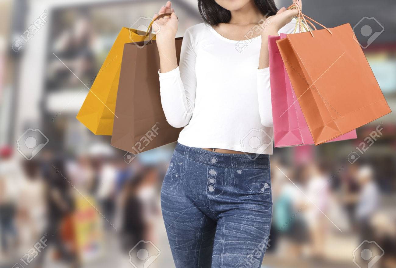 asian woman at shopping street with abstract blurred background Stock Photo - 78983851