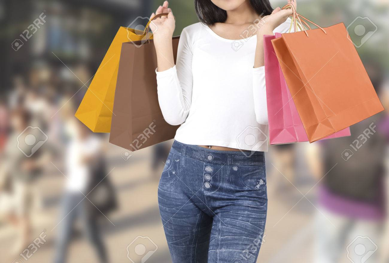 asian woman at shopping street with abstract blurred background Stock Photo - 78984754