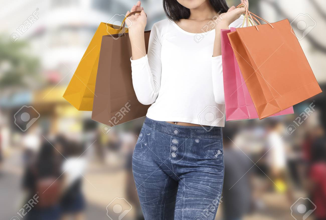 asian woman at shopping street with abstract blurred background Stock Photo - 78979134