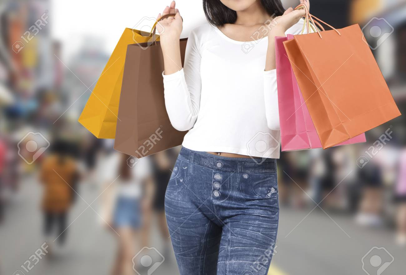 asian woman at shopping street with abstract blurred background Stock Photo - 78983849