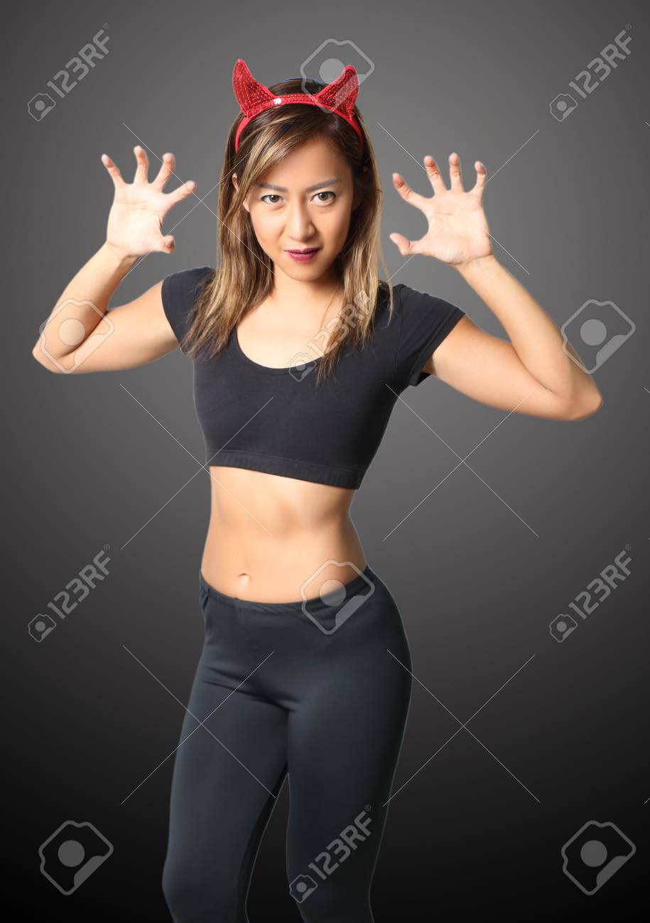 young asian woman witch in black clothes on black background Stock Photo - 90780049