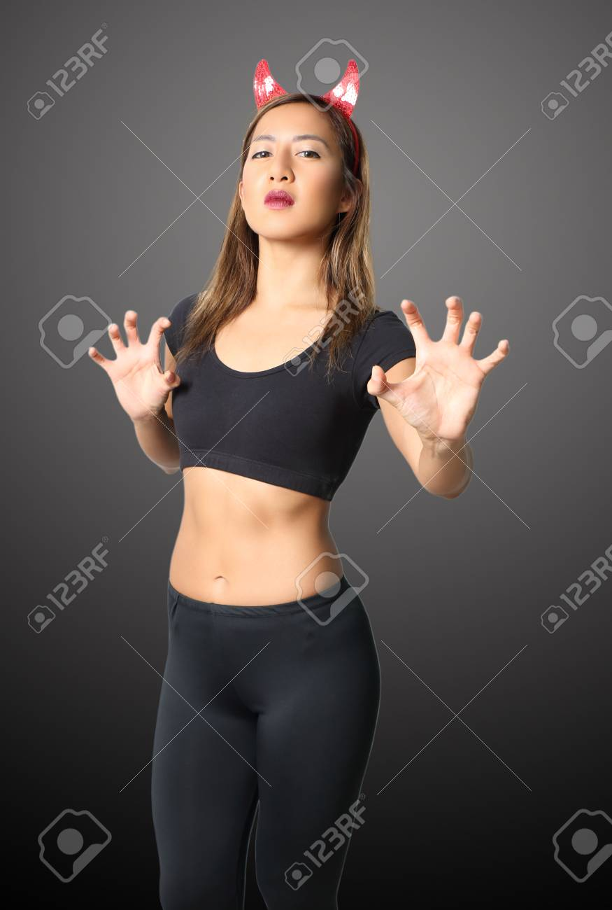 young asian woman witch in black clothes on black background Stock Photo - 87167738