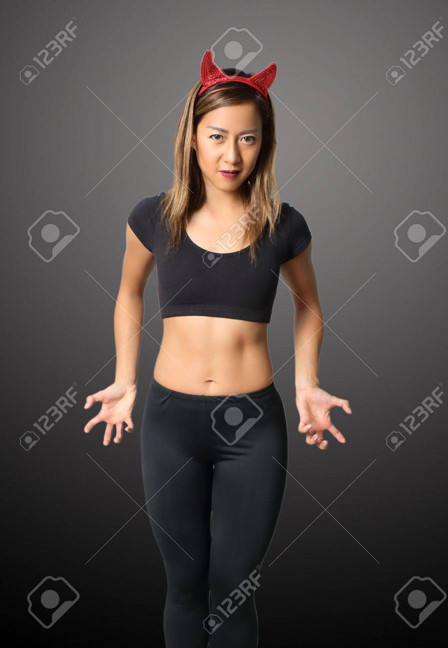 young asian woman witch in black clothes on black background Stock Photo - 87633795