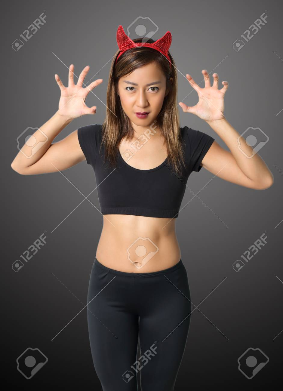 young asian woman witch in black clothes on black background Stock Photo - 87633796