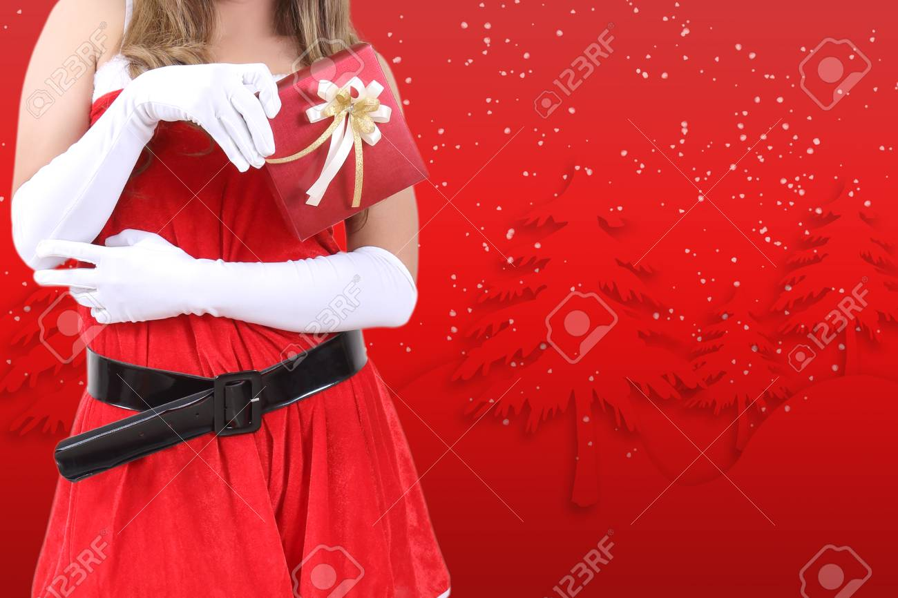 santa claus in red clothes holding gift box for christmas season Stock Photo - 89441681