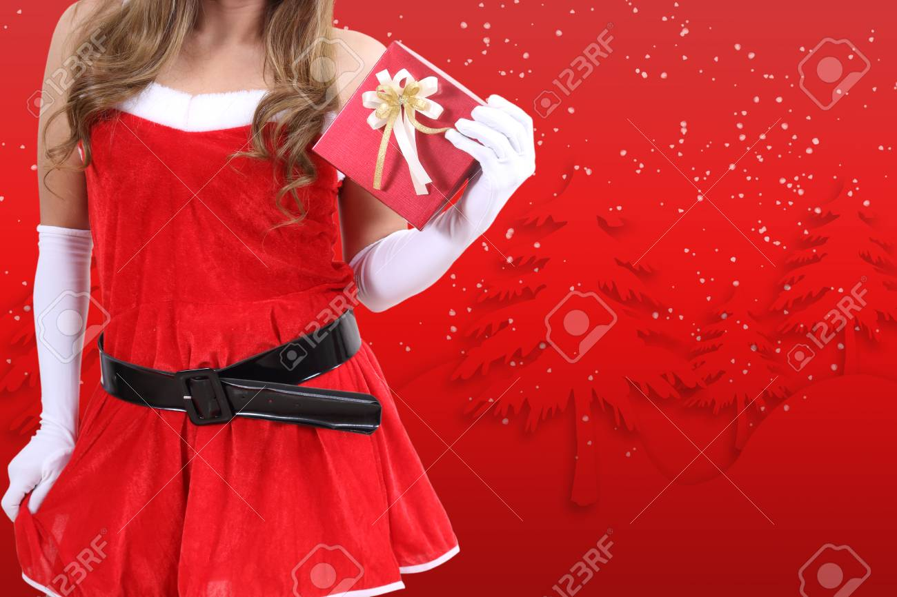 santa claus in red clothes holding gift box for christmas season Stock Photo - 89612627