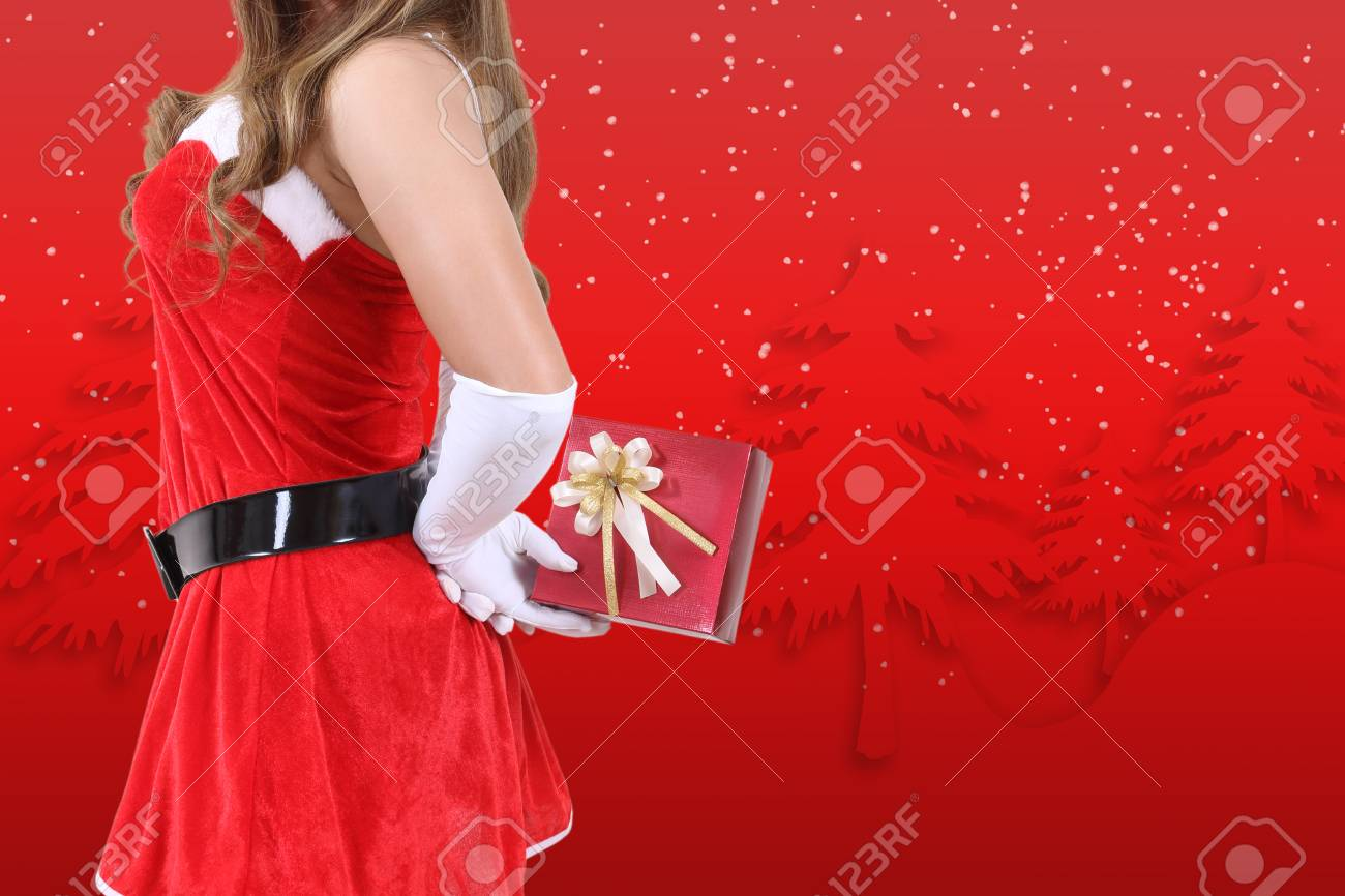 santa claus in red clothes holding gift box for christmas season Stock Photo - 89414242