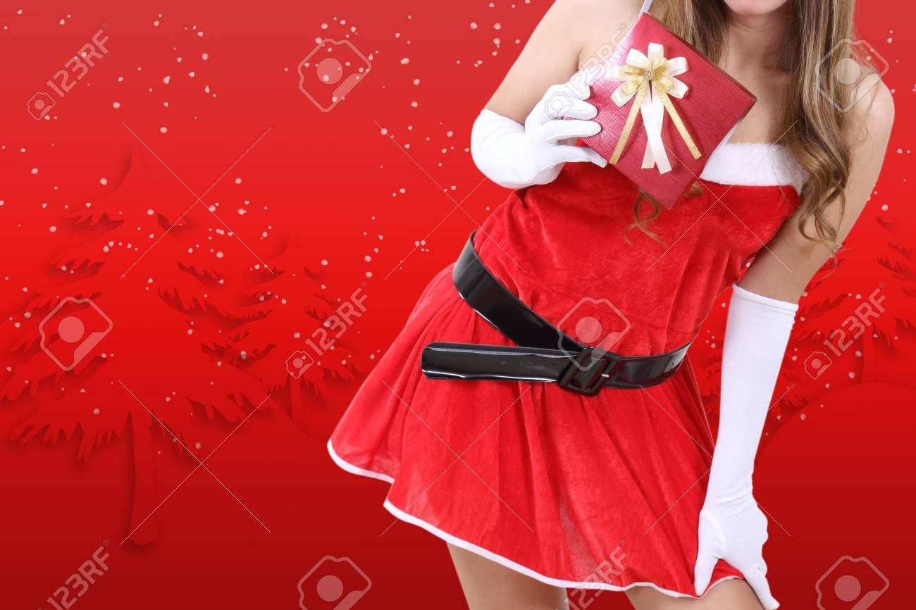 santa claus in red clothes holding gift box for christmas season Stock Photo - 89439377