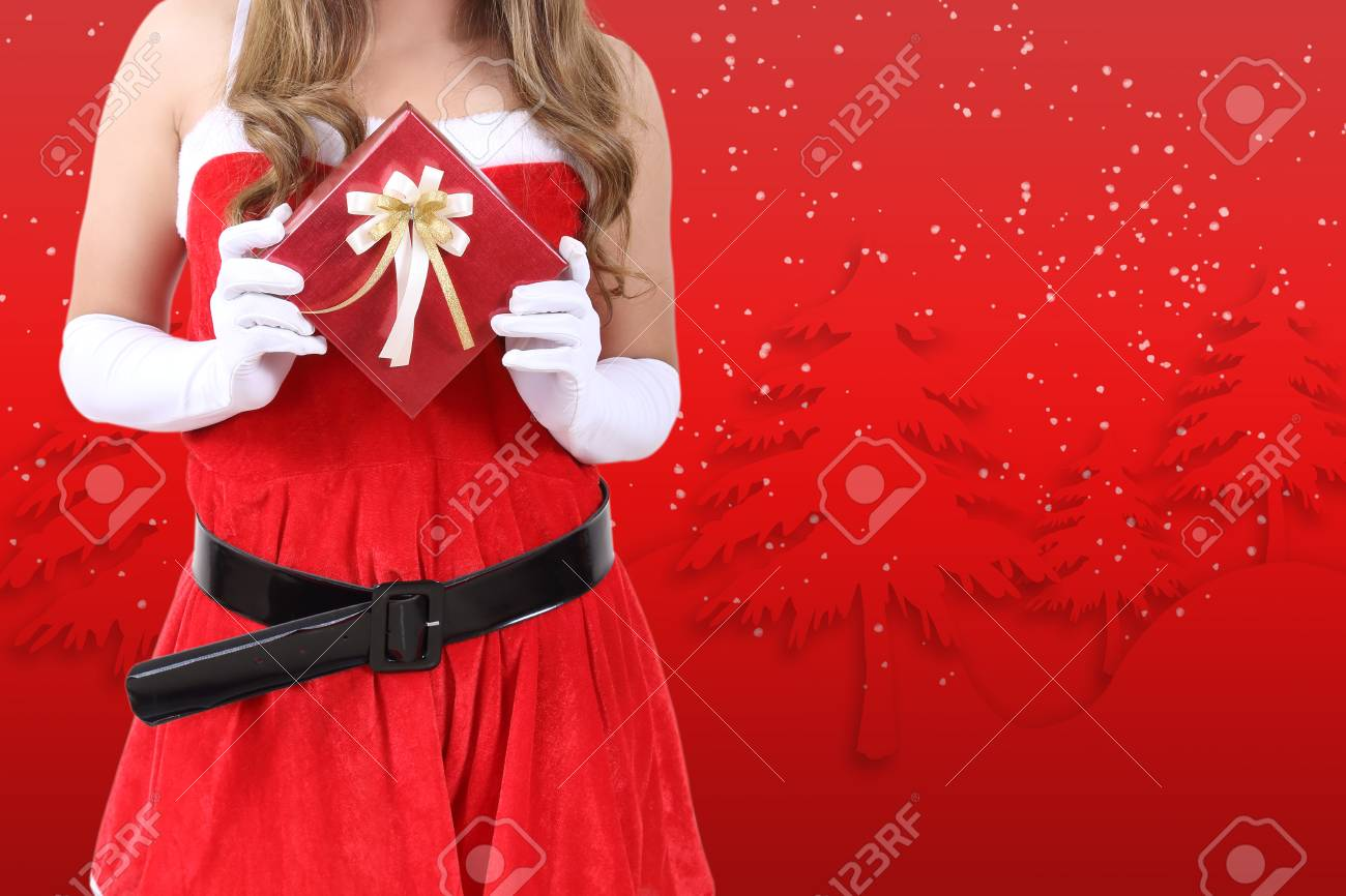 santa claus in red clothes holding gift box for christmas season Stock Photo - 89441683