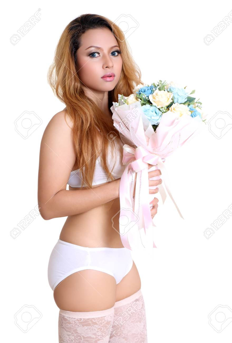 young beautiful asian woman holding flower in sexy bikini and white background Stock Photo - 90610535