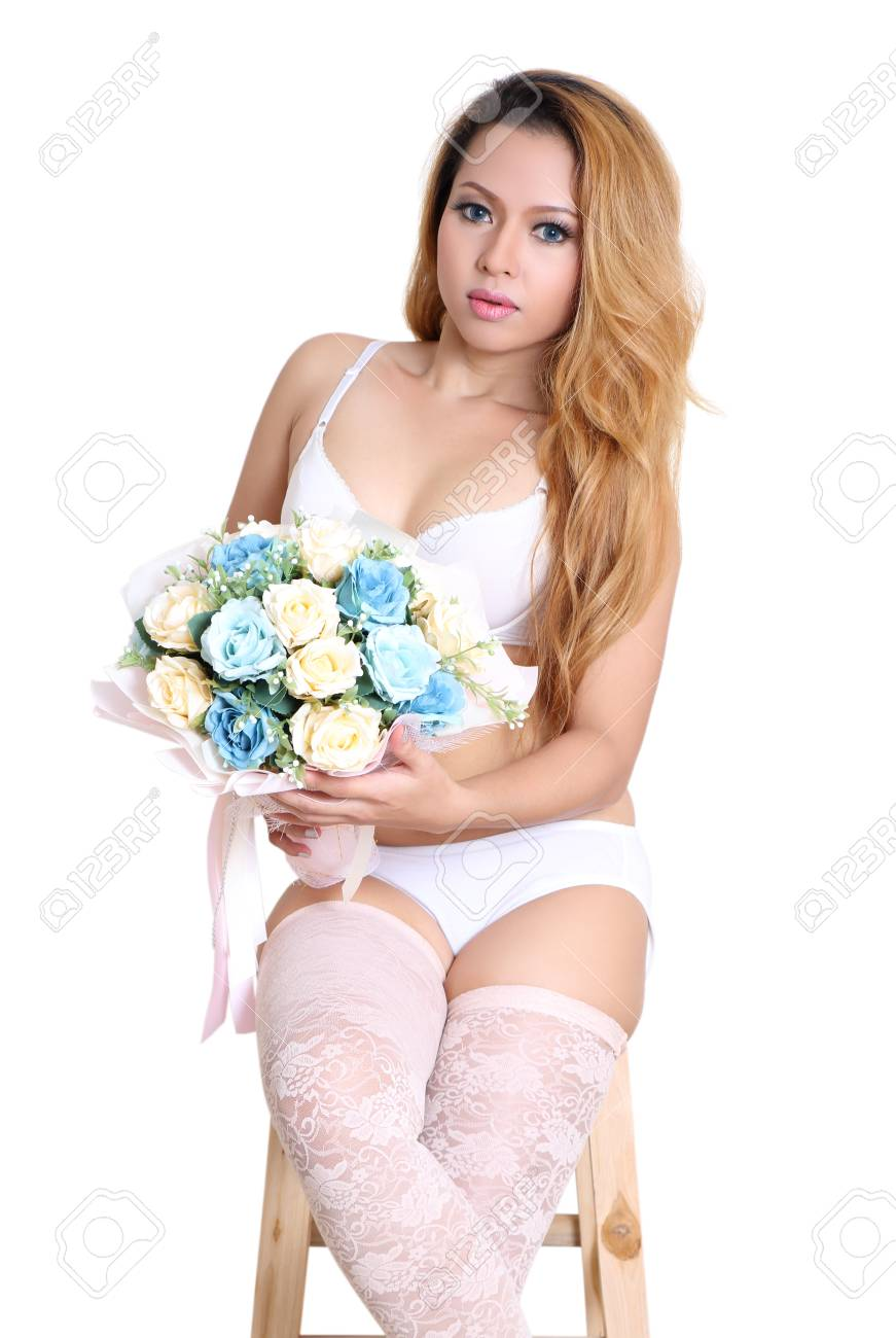 young beautiful asian woman holding flower in sexy bikini and white background Stock Photo - 90656679