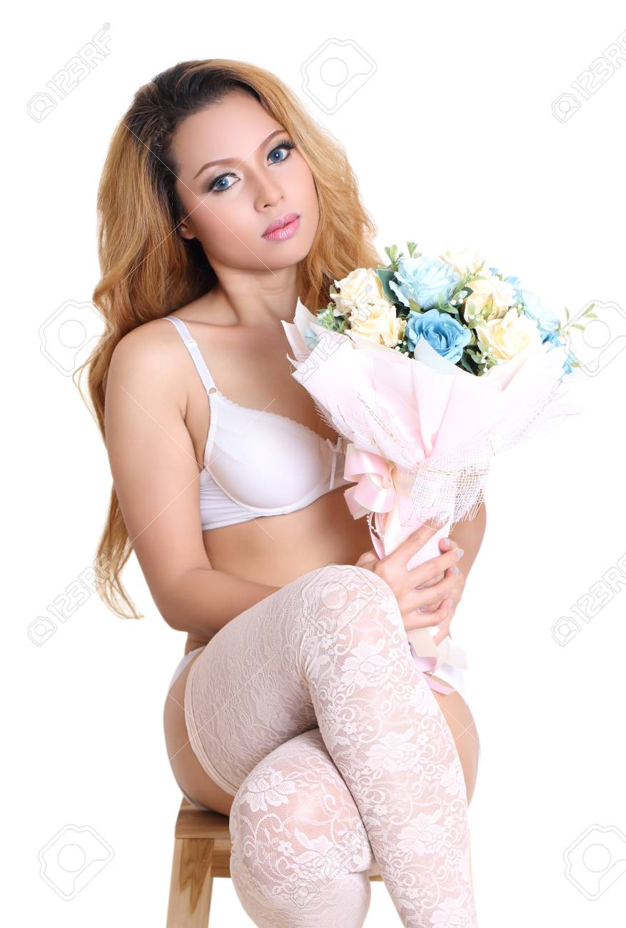 young beautiful asian woman holding flower in sexy bikini and white background Stock Photo - 90743900