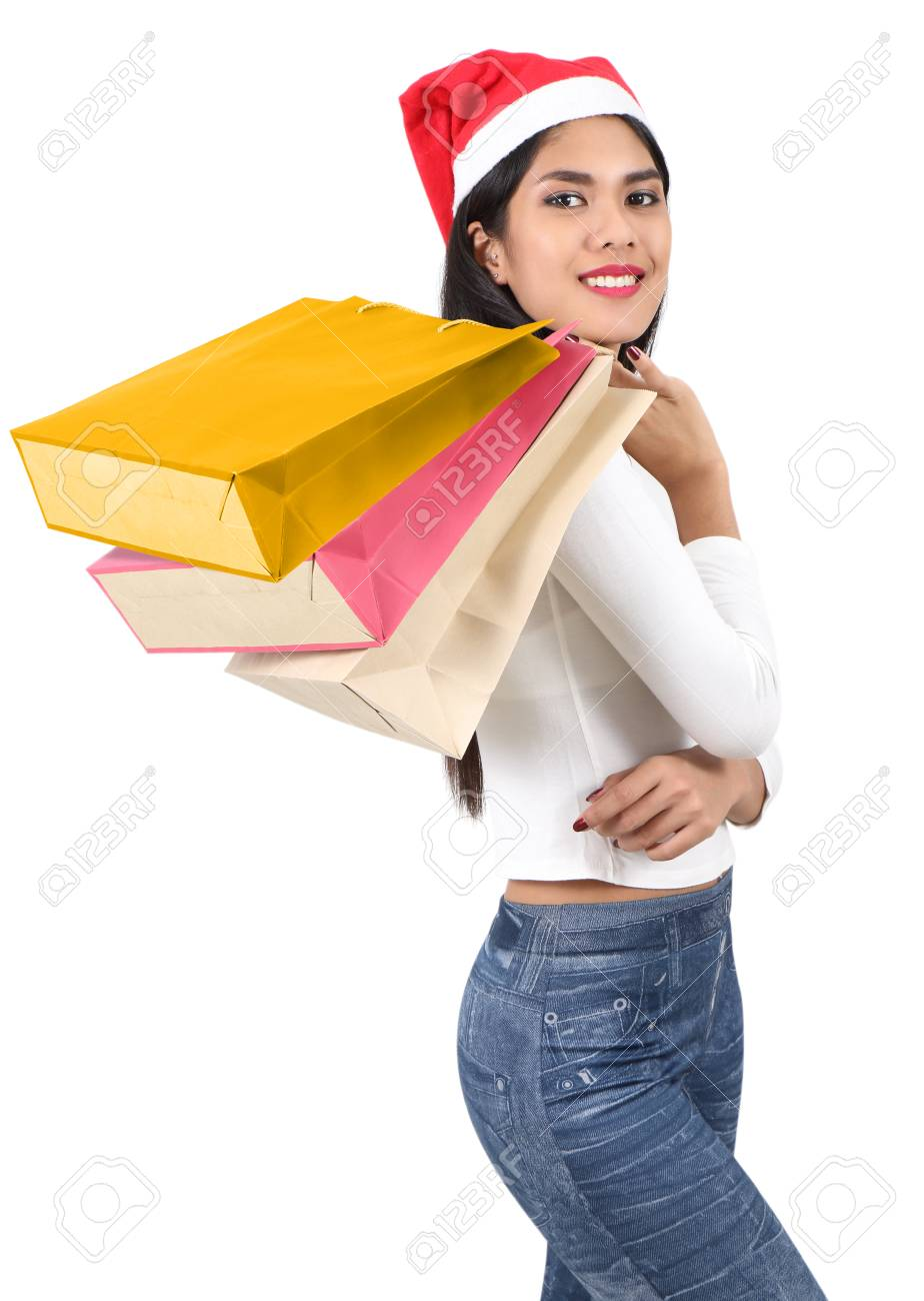 beautiful asian woman with red hat holding shopping bag for christmas Stock Photo - 91257649