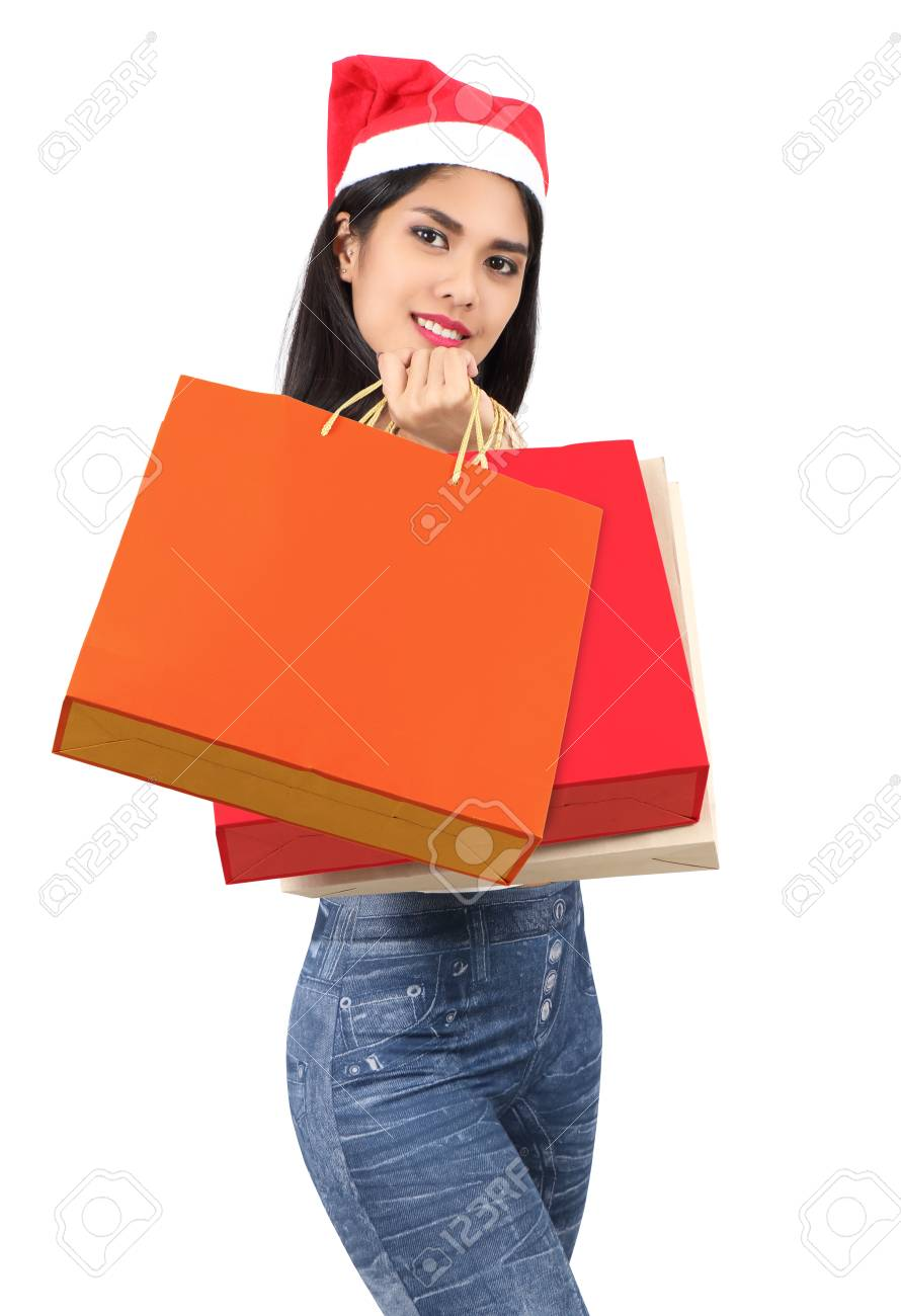 beautiful asian woman with red hat holding shopping bag for christmas Stock Photo - 91601106