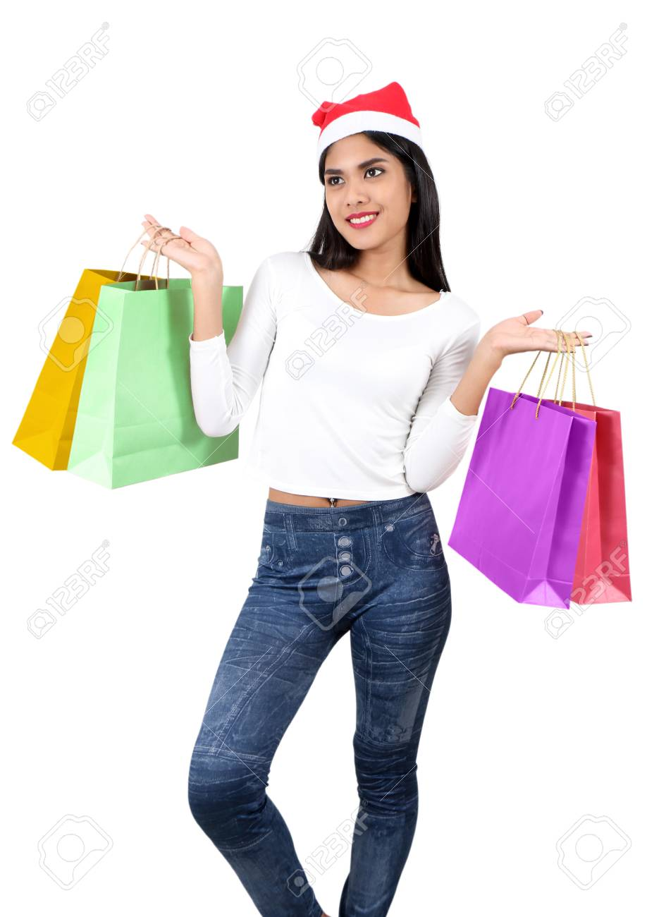 beautiful asian woman with red hat holding shopping bag for christmas Stock Photo - 91316057