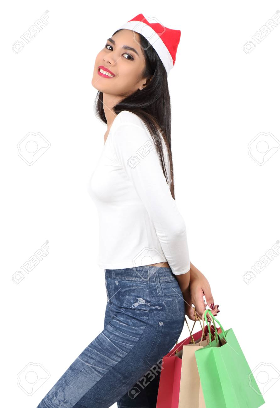 beautiful asian woman with red hat holding shopping bag for christmas Stock Photo - 91301934