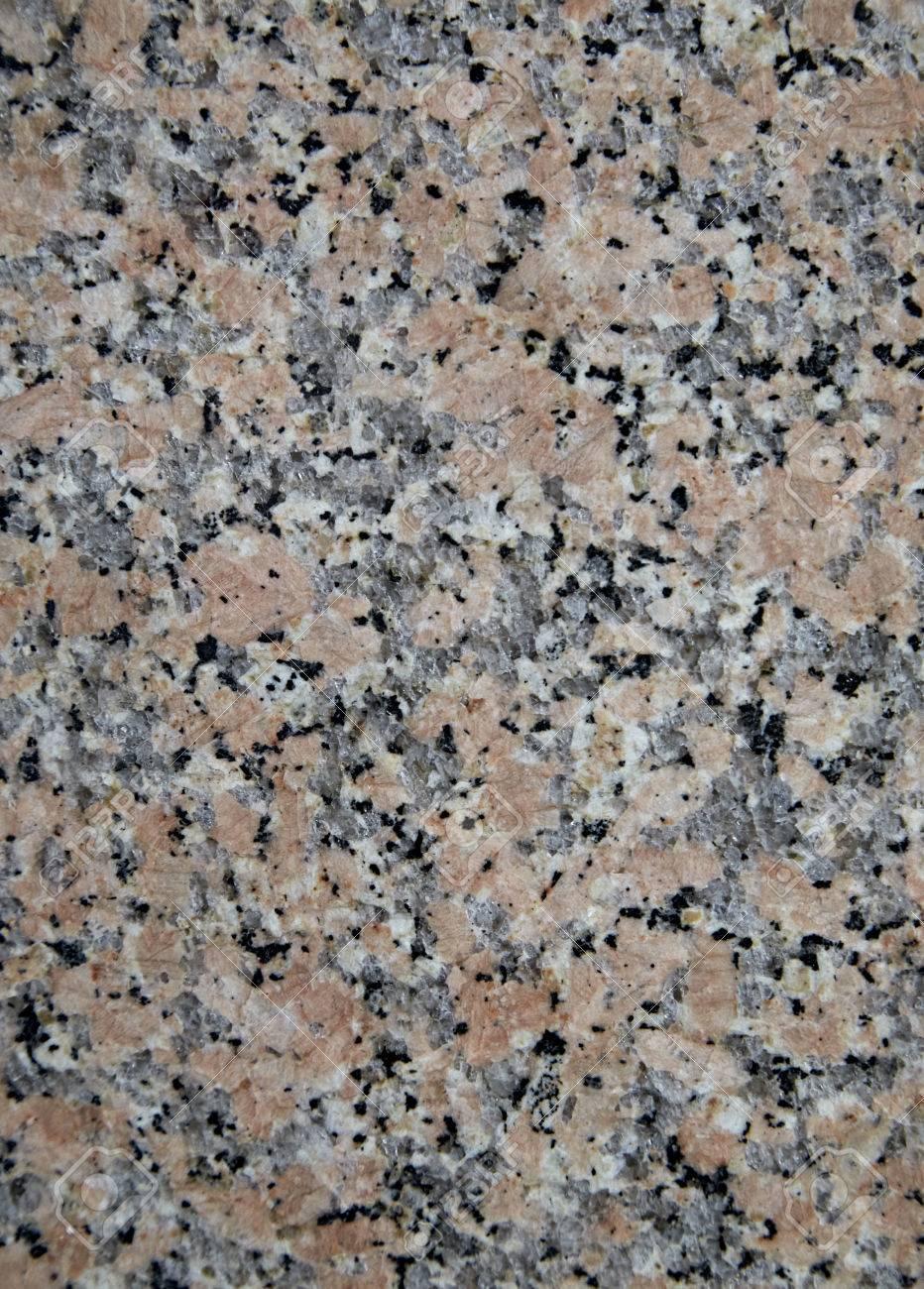 textura de piedra natural de color rosarojo con una gran cantidad