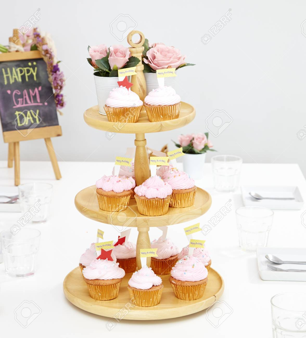 Pink Cupcakes On Wooden Cupcake Stand