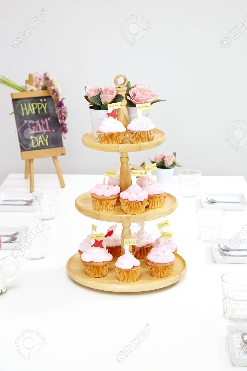 Pink Cupcakes On Wooden Cupcake Stand Stock Photo, Picture And ...
