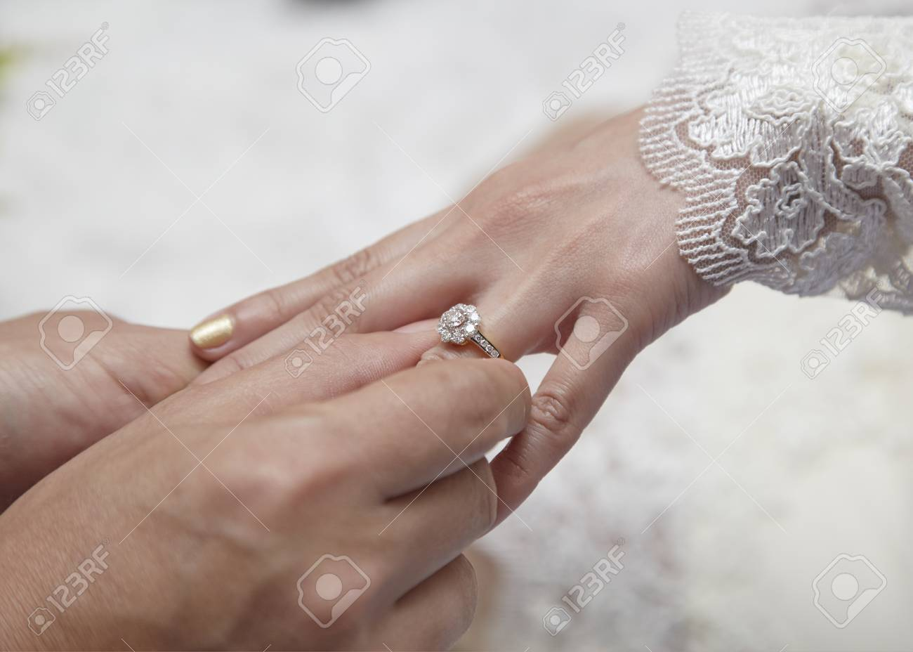 Male Hand Wear Diamond Ring In To Female Finger Stock Photo, Picture ...