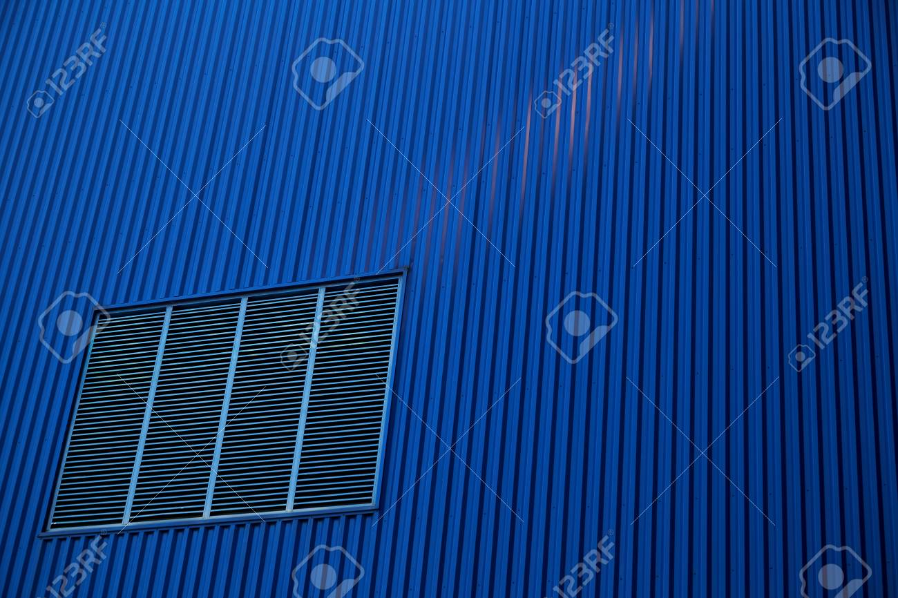 Metal Sheet Wall Panels And Roofs Against Clear Blue Sky Stock Photo ...