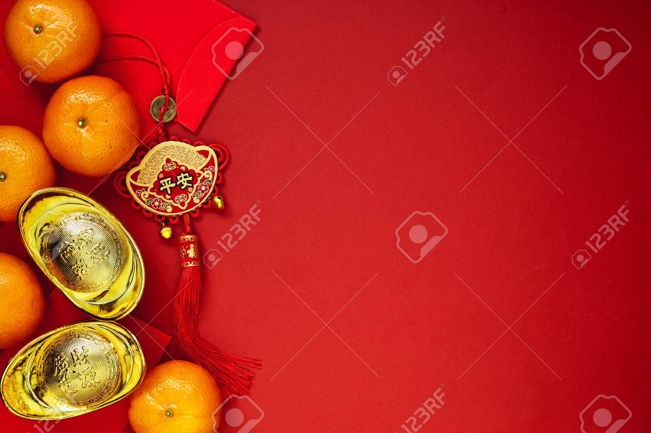 Chinese coins of luck or chinese knot and Chinese gold ingots and Traditional chinese knot (Foreign text means blessing) and Red envelopes and decoration with Fresh oranges on Red Paper background - 89269062