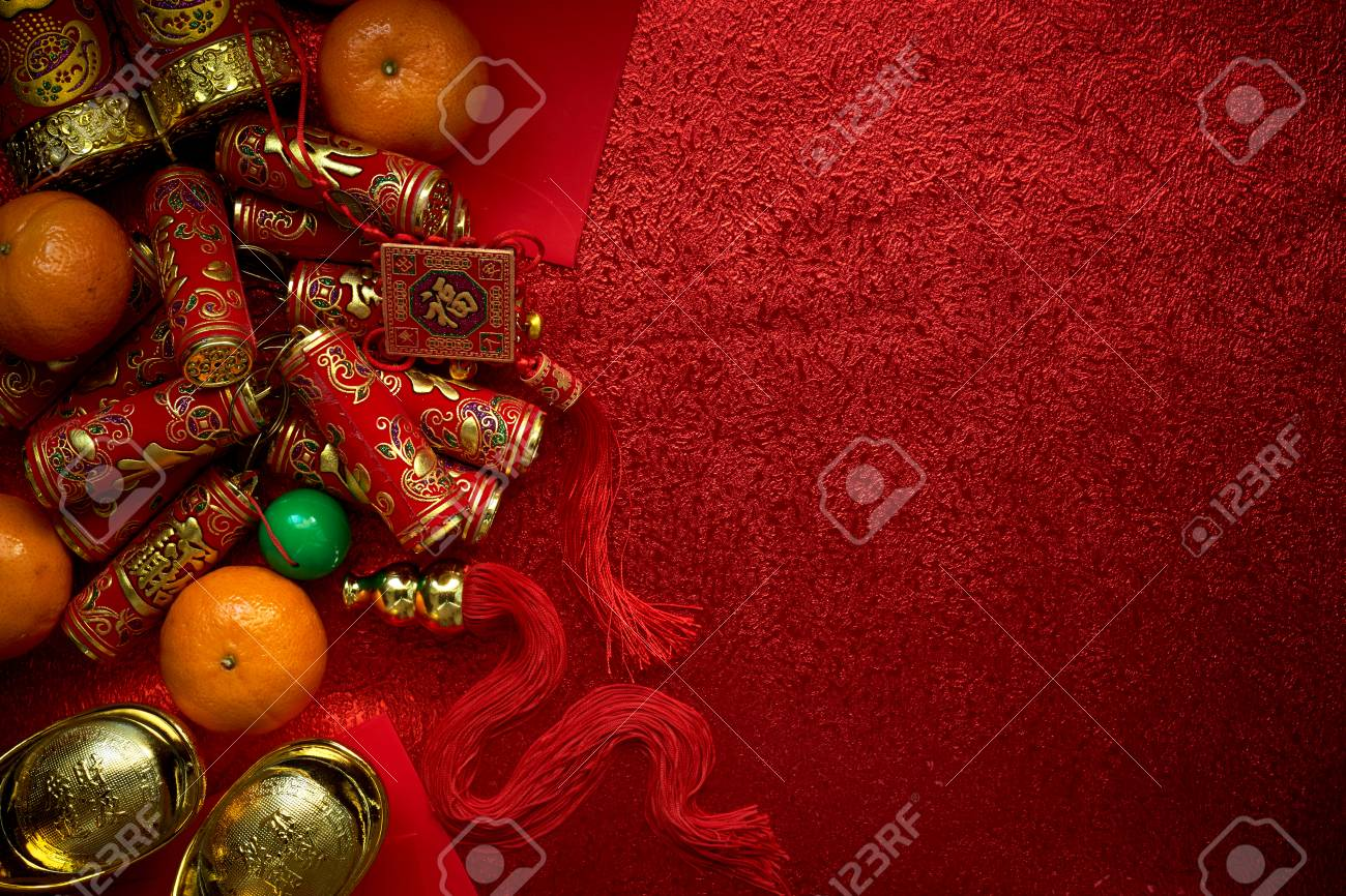 Chinese coins or Chinese knot of luck and chinese firecrackers and Chinese gold ingots and Traditional chinese knot (Foreign text means blessing) and Red envelopes and decoration with Fresh oranges on Red Paper background - 89269223