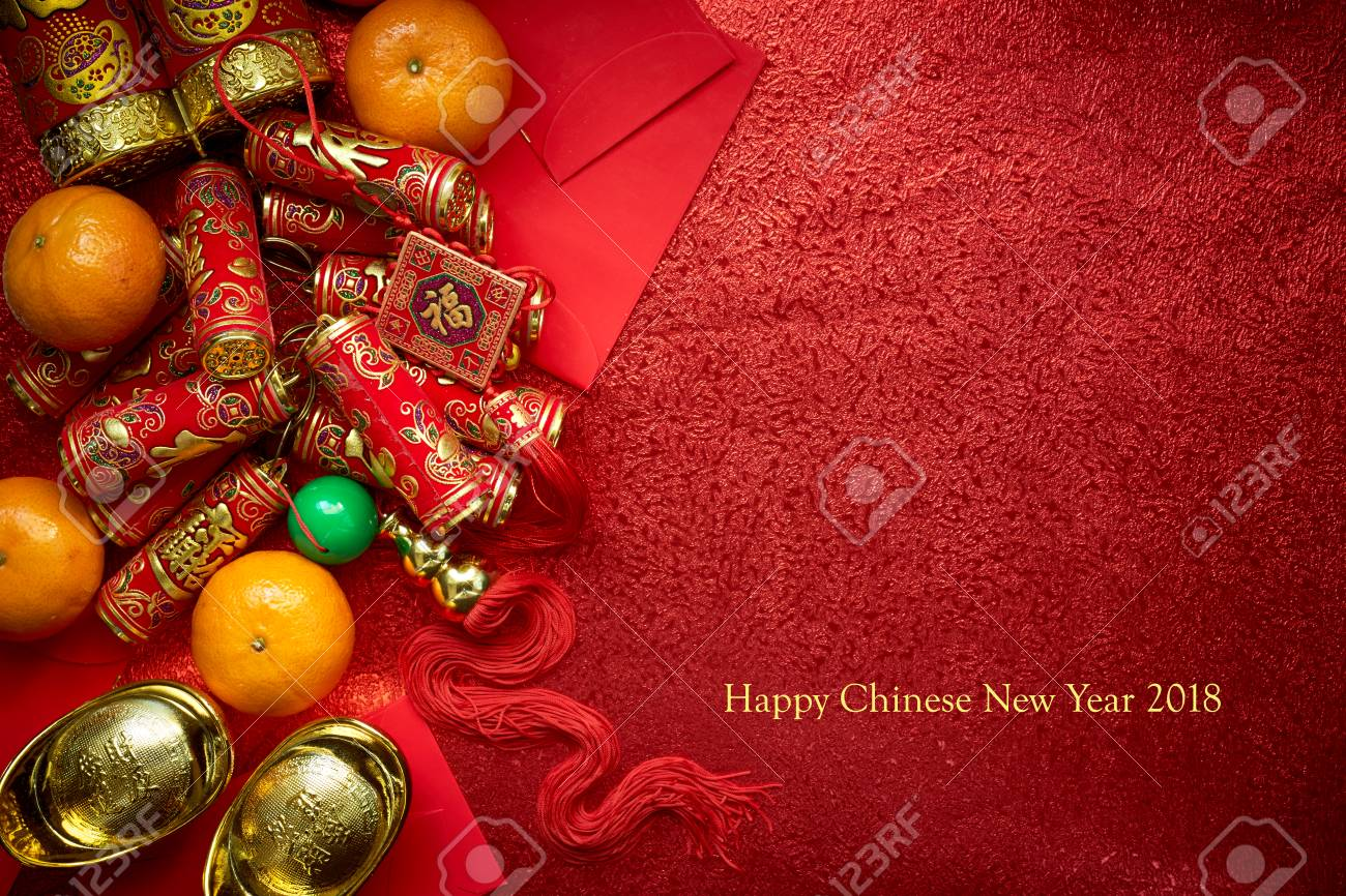 Chinese coins or Chinese knot of luck and chinese firecrackers and Chinese gold ingots and Traditional chinese knot (Foreign text means blessing) and Red envelopes and decoration with Fresh oranges on Red Paper background - 90279932