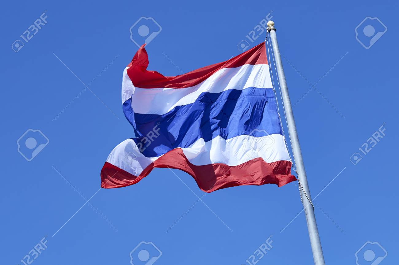 State national flag of Thailand waving on blue sky background. - 91197052