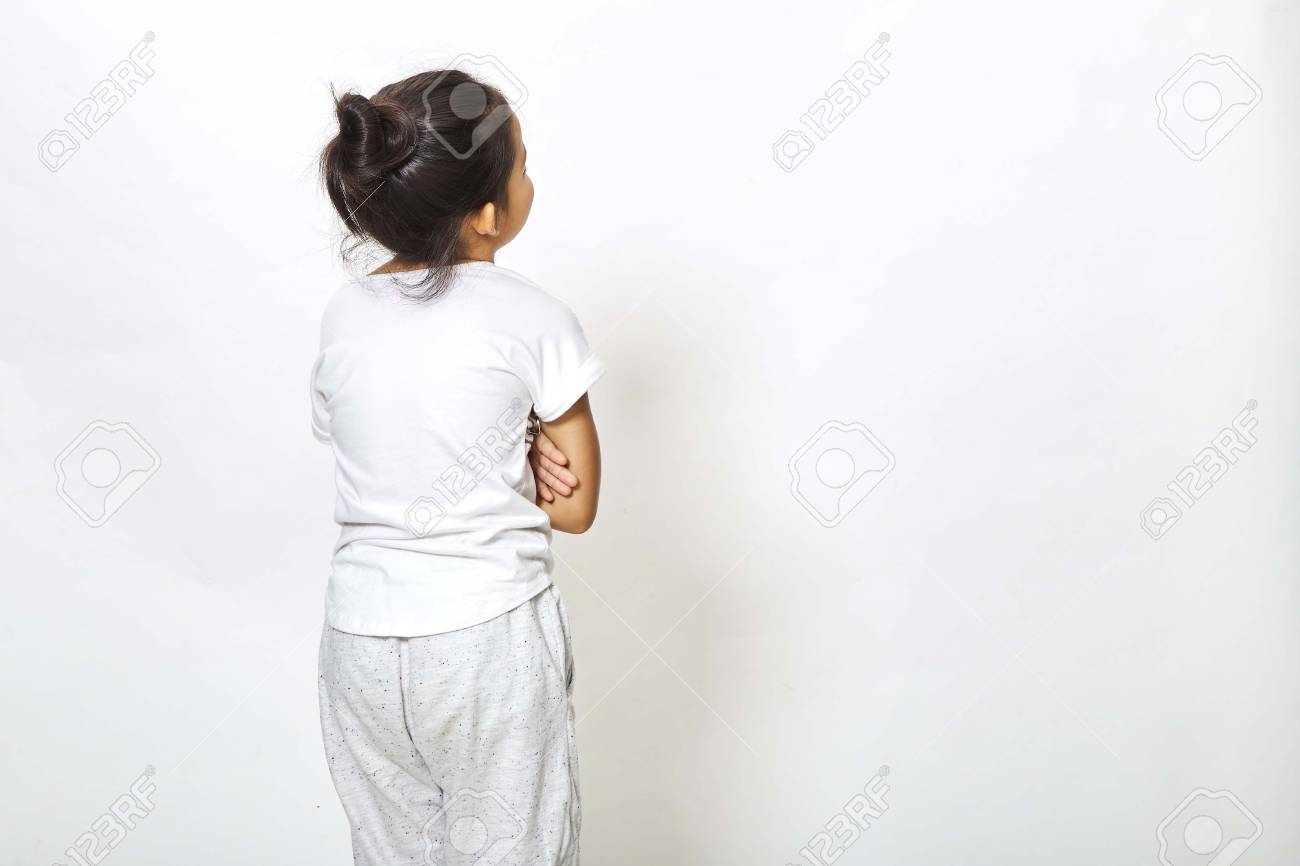 Back view of little girl looking at wall. Rear view on white background, Back to school concept - 100588703