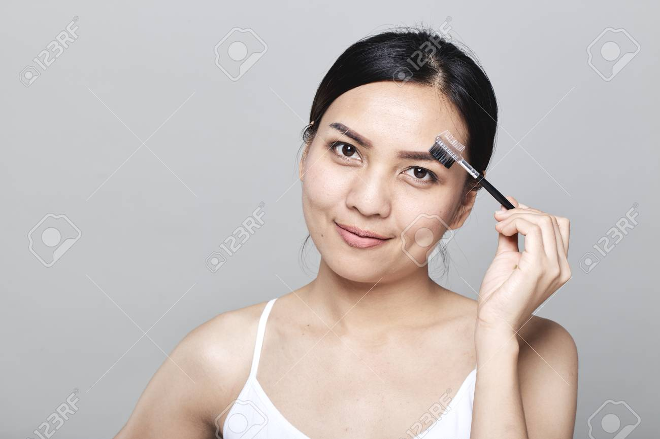 Beautiful Asian Women Are Eyebrows On Light Gray Background Stock