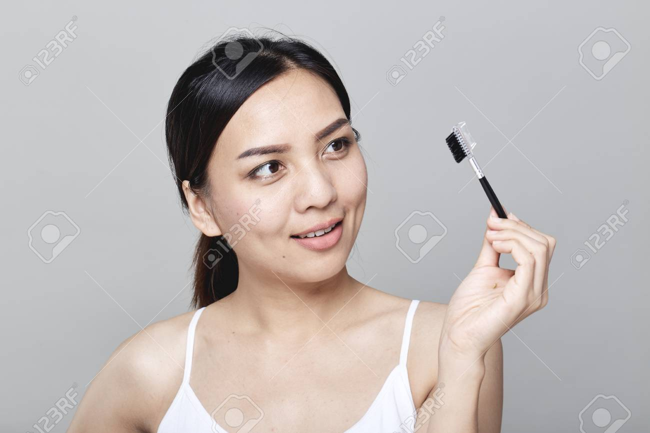 Beautiful Asian Women Are Eyebrows On Light Gray Background