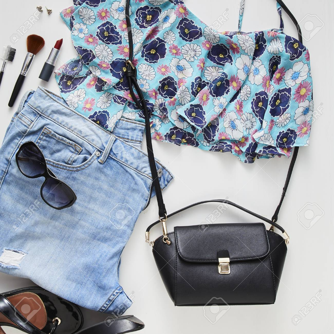 18f6b1176cc2 flat lay feminine clothes and accessories collage with jean,sunglasses,  earring White wood table