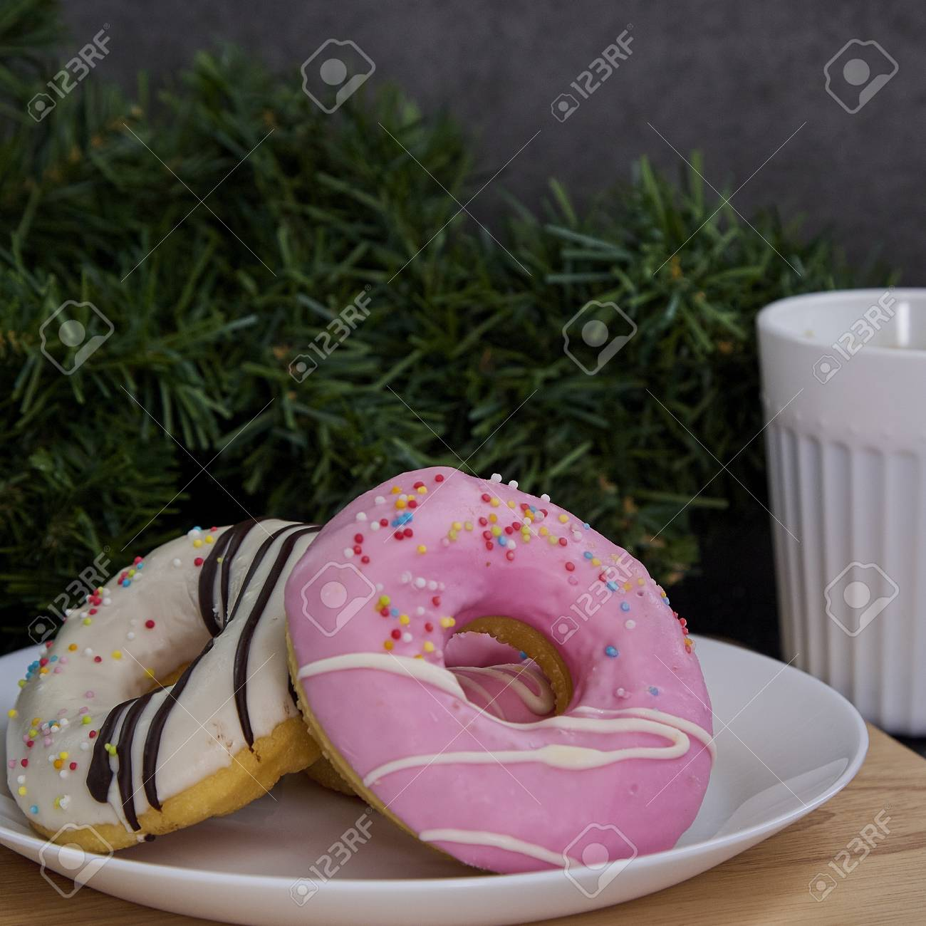 Pink Donuts On Plate Withe Coffee On The Dark Wooden Background Stock Photo Picture And Royalty Free Image Image 113691406