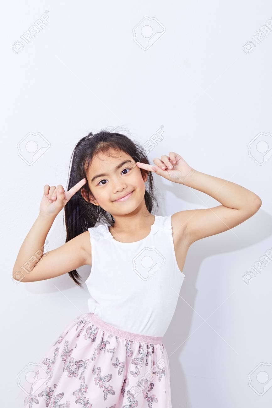 9 year old girl Portrait of Asian girl children smiling at room the bright gray wall smiling inspiration concept ideas, Fashion, education and health - 126249232