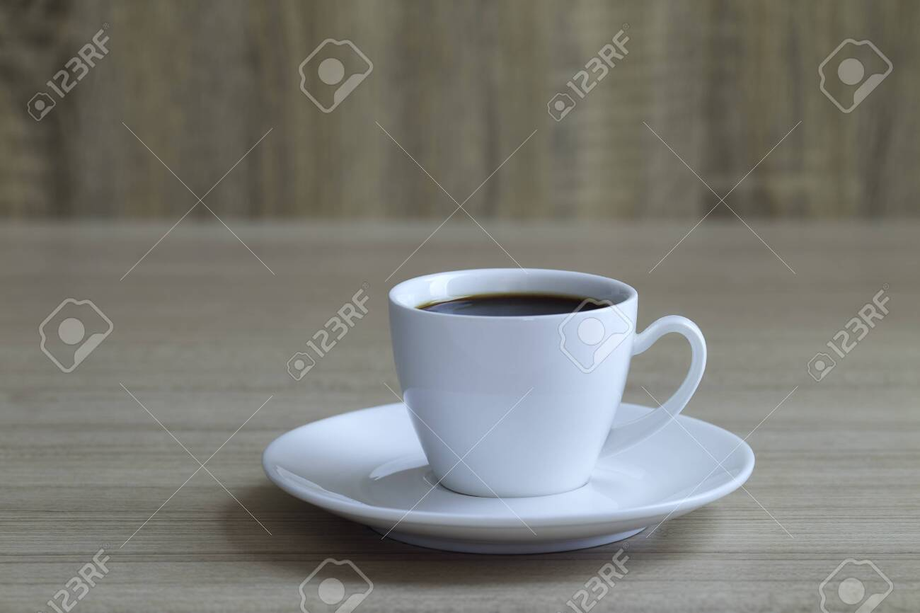 Minimal, Black coffee cup on wooden table with copy space - 120394949