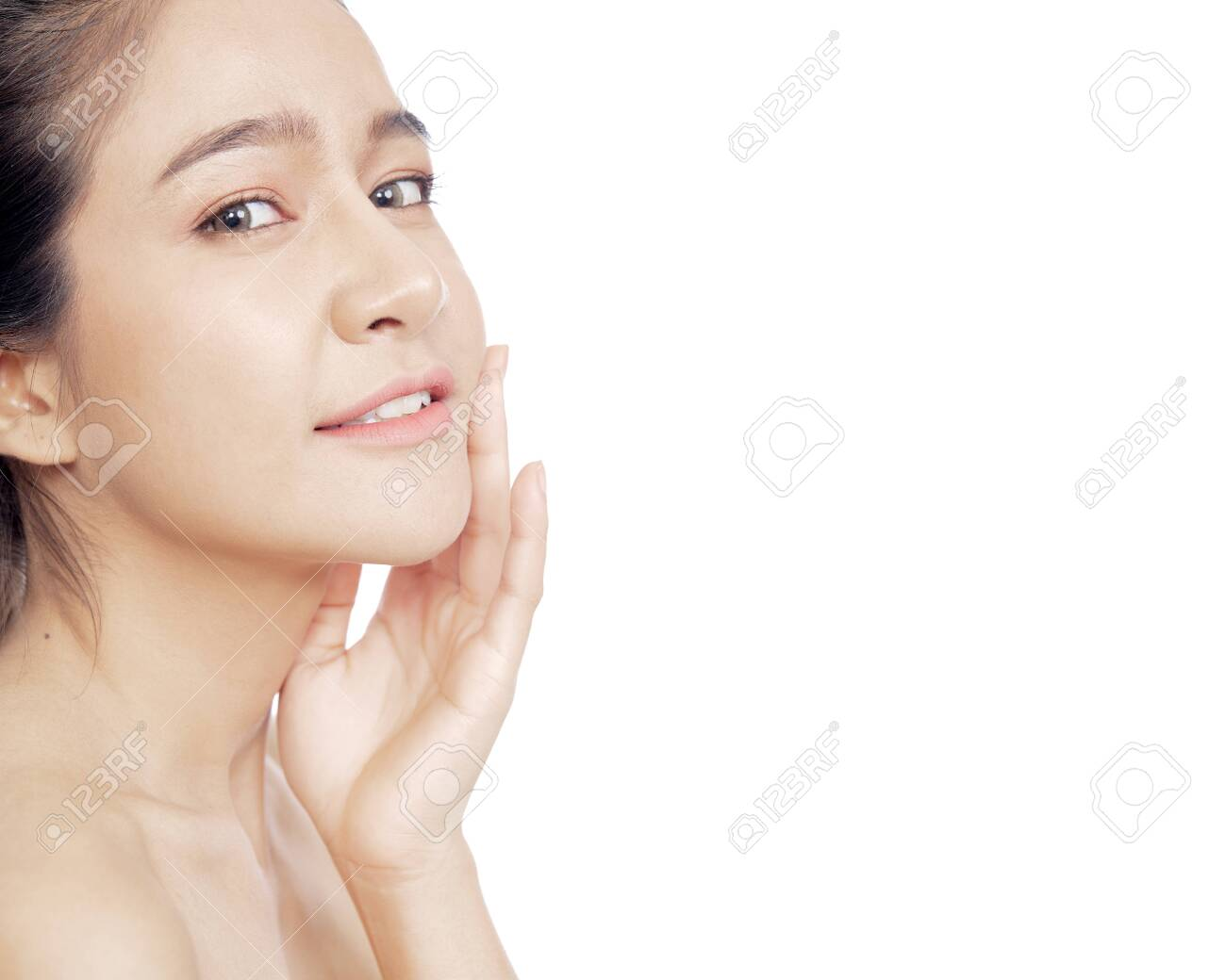 Close up young Thai woman beautiful face on white background for beauty and skin care concepts - 147504663