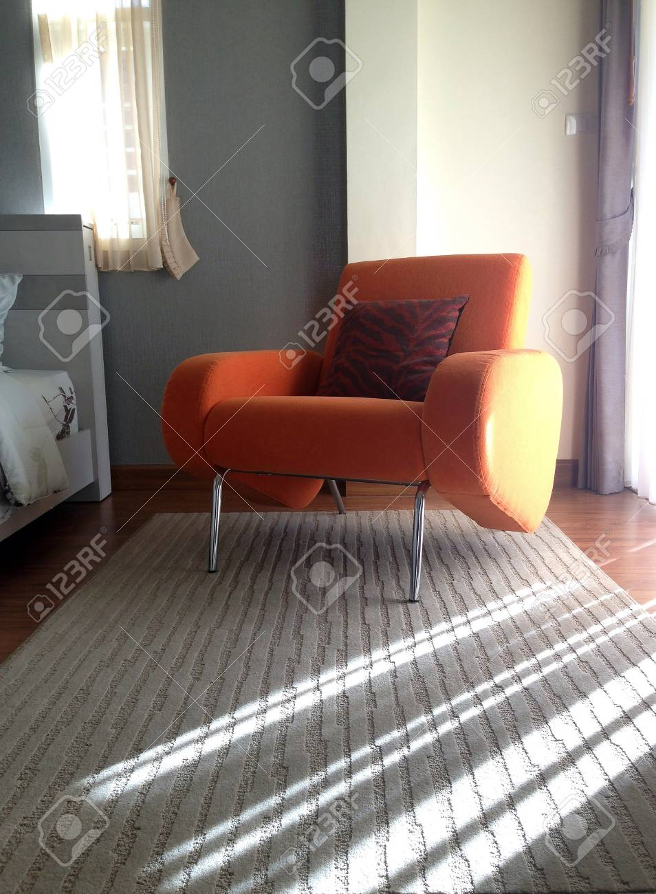 Interior, room with comfortable armchair orange Stock Photo - 23744107