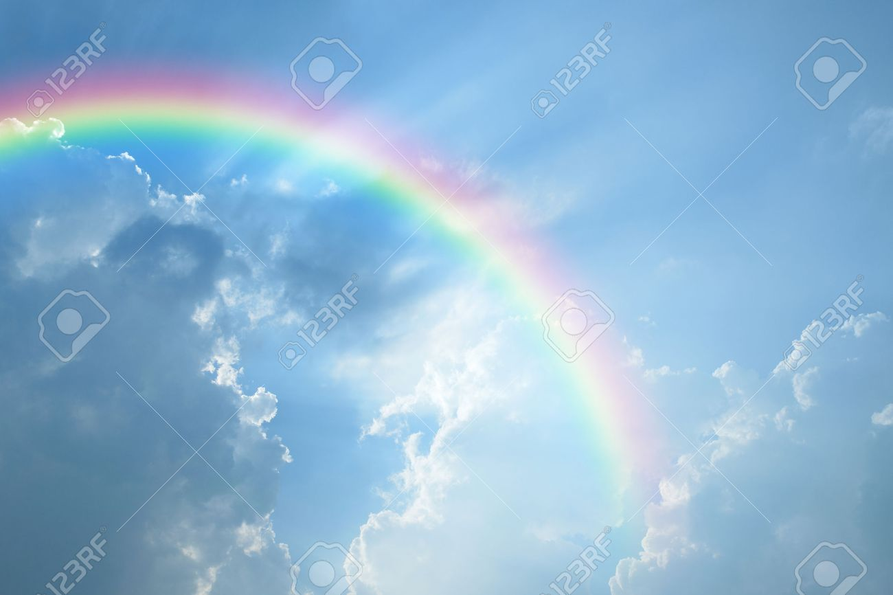 Blue sky and white cloud with sun light and rainbow - 39613885