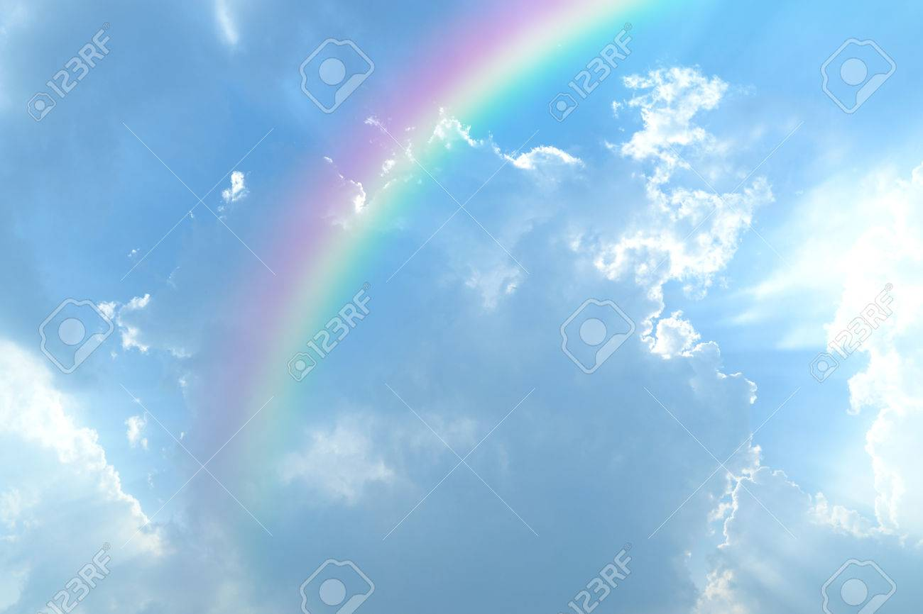 Blue sky and white cloud with sun light and rainbow - 39696152