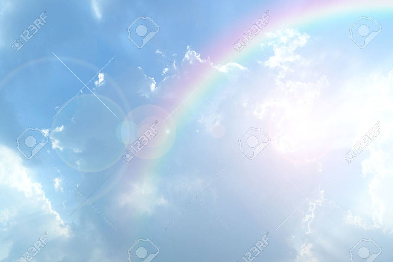 Blue sky and white cloud with sun light and rainbow - 39696157