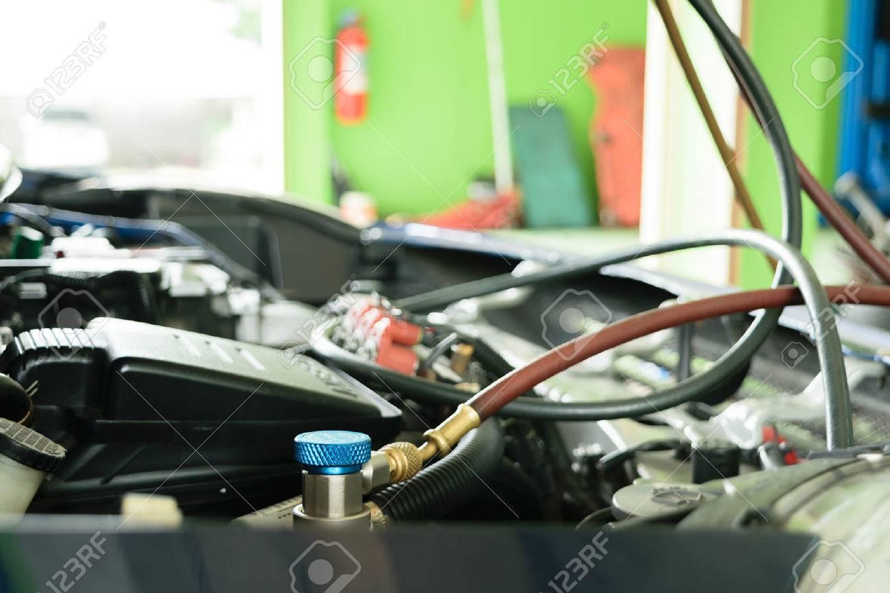 Car refilling air condition in air shop - 43878407