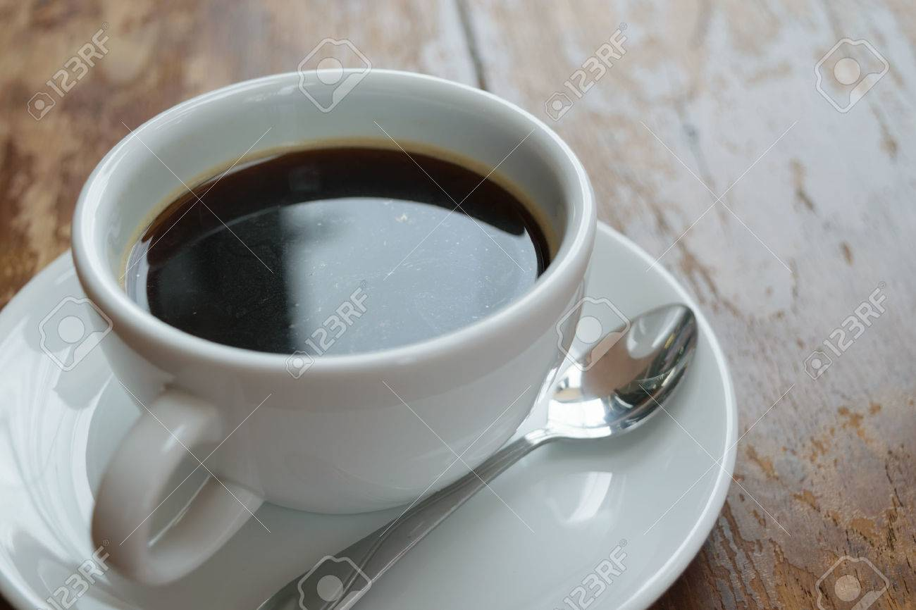 Coffee in white cup on wood table - 45573273