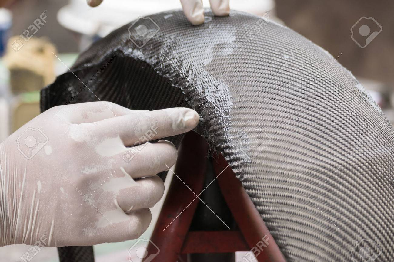 Wrapping carbon fiber or kevlar and man hand for working - 51555413