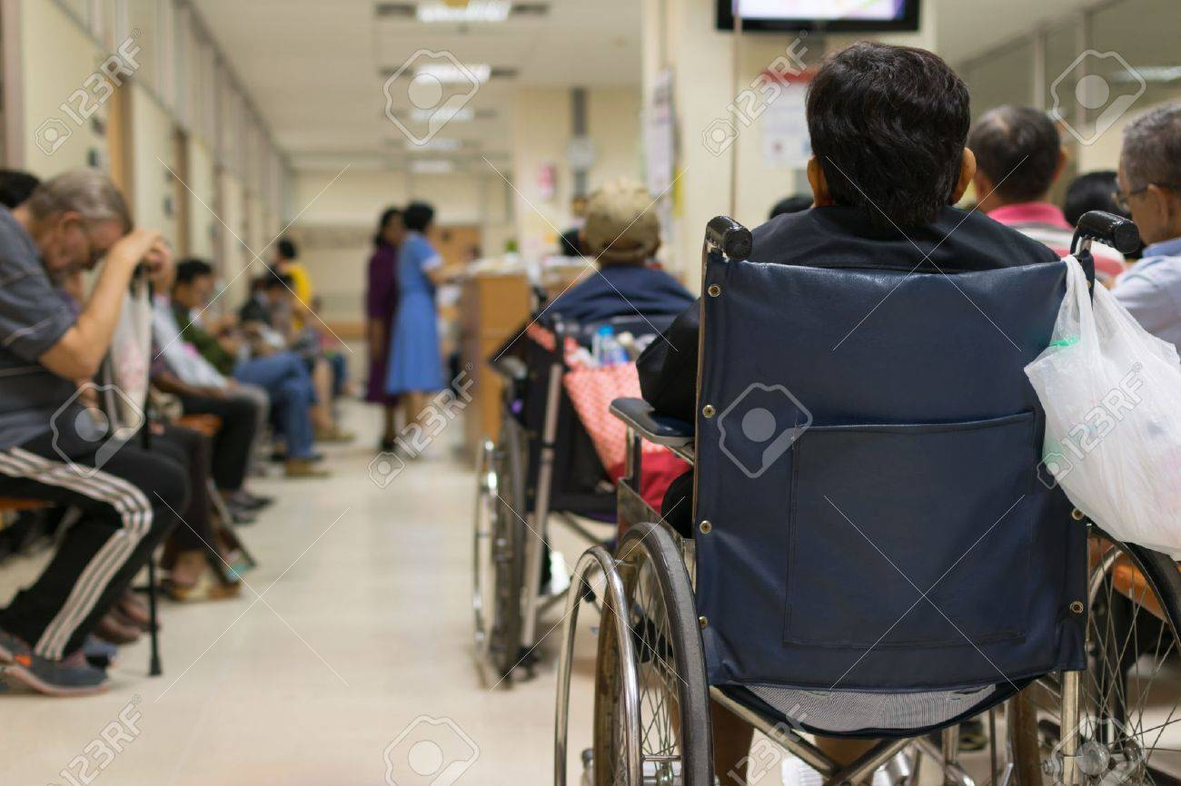 Patient elderly on wheelchair and many patient waiting a doctor and nurse in hospital - 52918538