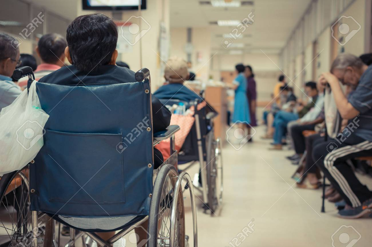 Patient elderly on wheelchair and many patient waiting a doctor and nurse in hospital - 57780208