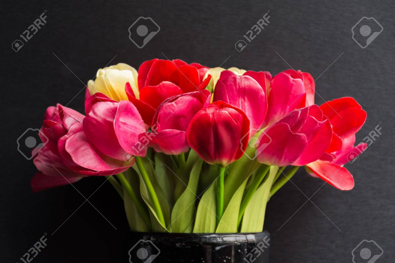 Beautiful Tulips Flower Red Color In Black Vase On Black Background ...
